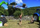 Lady competes in sheaf toss at Lustleigh Village Show
