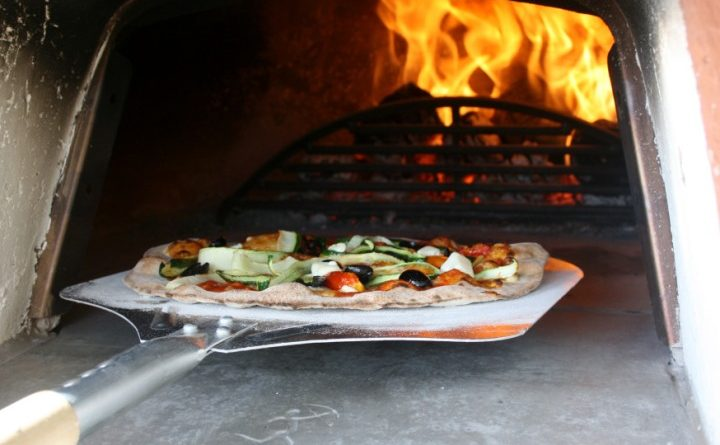 A hand made pizza in the wood fired oven of the Travelling Pizzeria