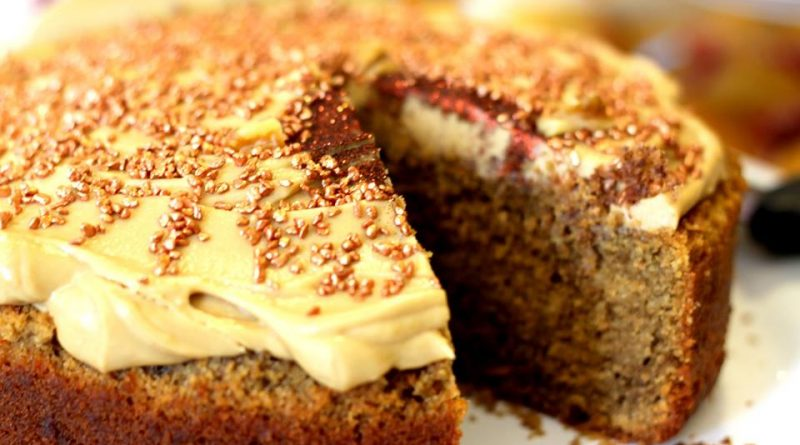 Close up of an iced coffee cake, topped with glittering crunchy pieces at a Pop Up Tea Shop