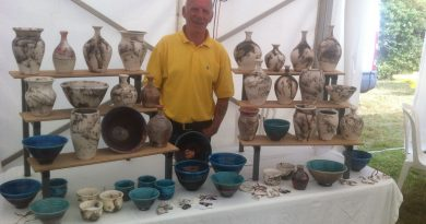 Ben Mcmanigan with a selection of his horse hair pottery