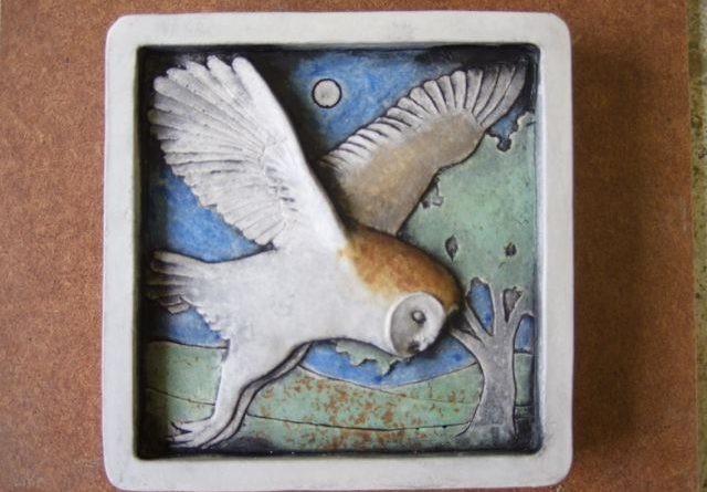 A concrete cast tile featuring an owl and made by Tactile Designs