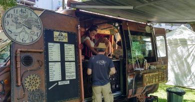 A customer buys from the steampunk inspired Cognitive Coffee Company van