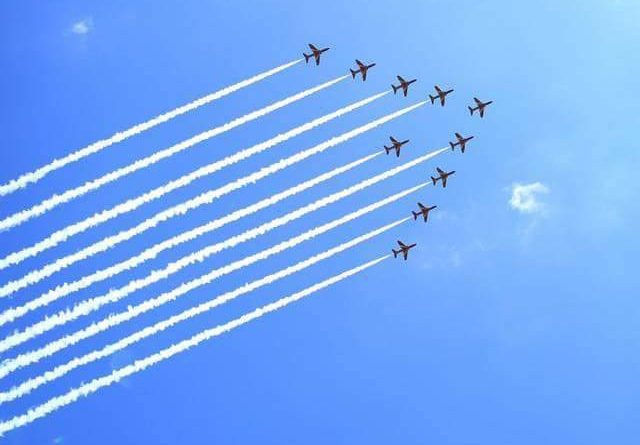 The nine hawk jets of the RAF Red Arrows cross the Lustleigh Show in 2016